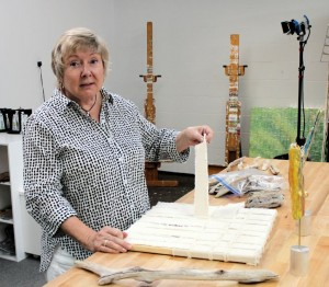 Diane demonstrating strips her canvases are made of